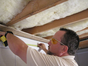 Finishing Specialist Installing a Basement Finishing System